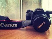 Продаю б/у зеркальный фотоаппарат Canon